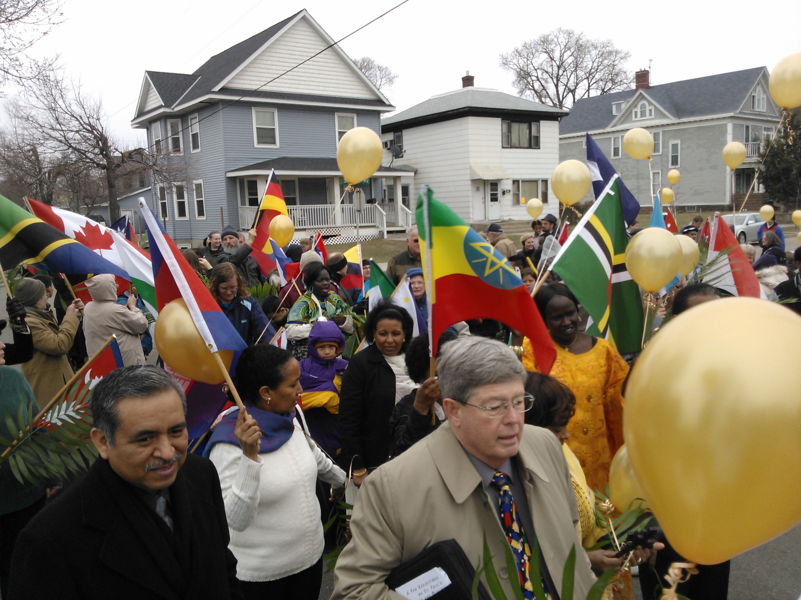 Reverend Roland Wells (Center) helps to lead the colorful march.