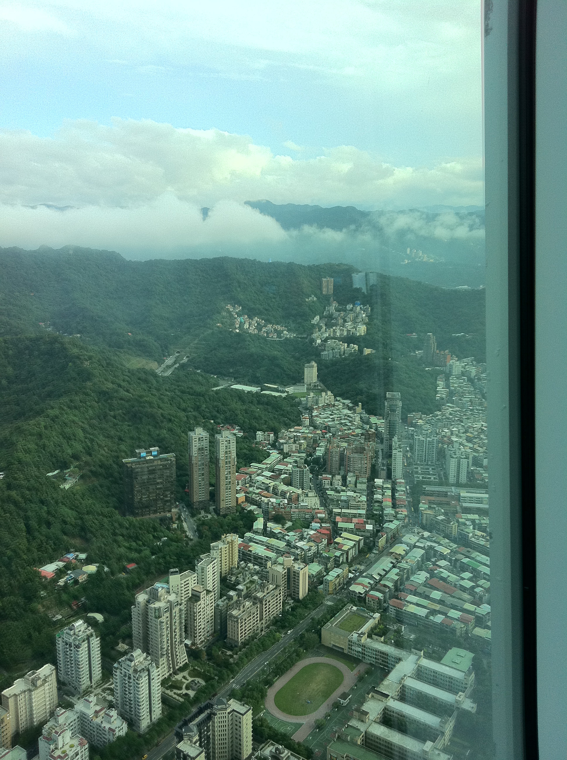 The City of Taipei runs straight into forested hills (View from Taipei 101)