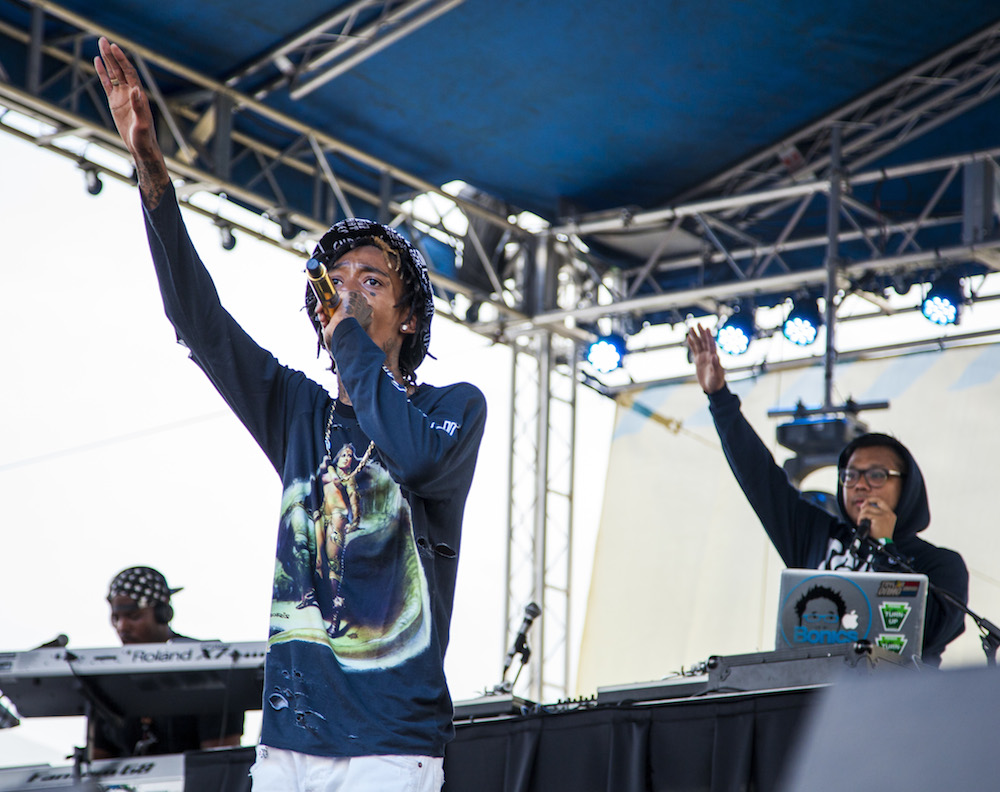 Wiz Khalifa salutes his fans for their support.