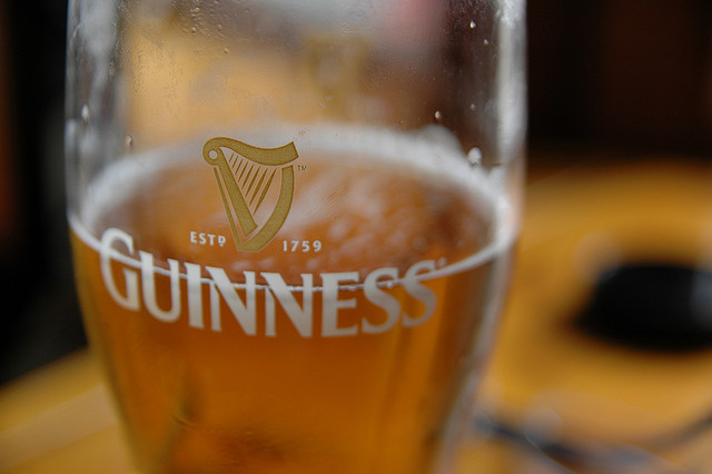 Light colored beer in a Guinness glass - Jeff Kubina