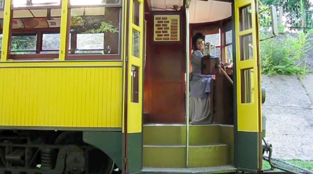 Alexandra Howes dressed in 1905 clothing aboard one of the streetcars.